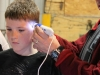 mini_maker_fair___microscope_with_kid_looking_at_hair
