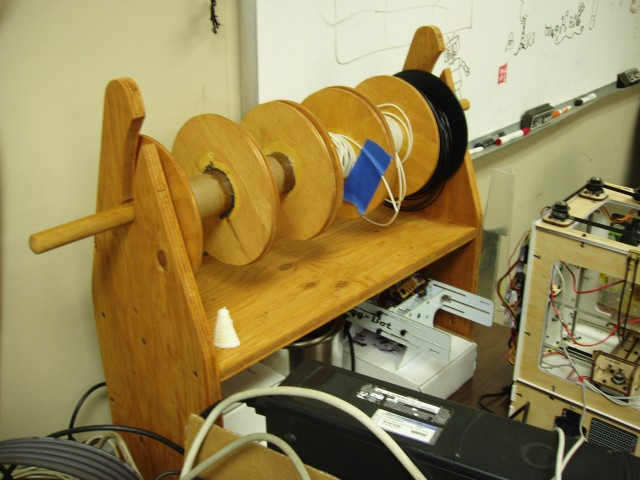 Image of the spool holder filled with spools of plastic