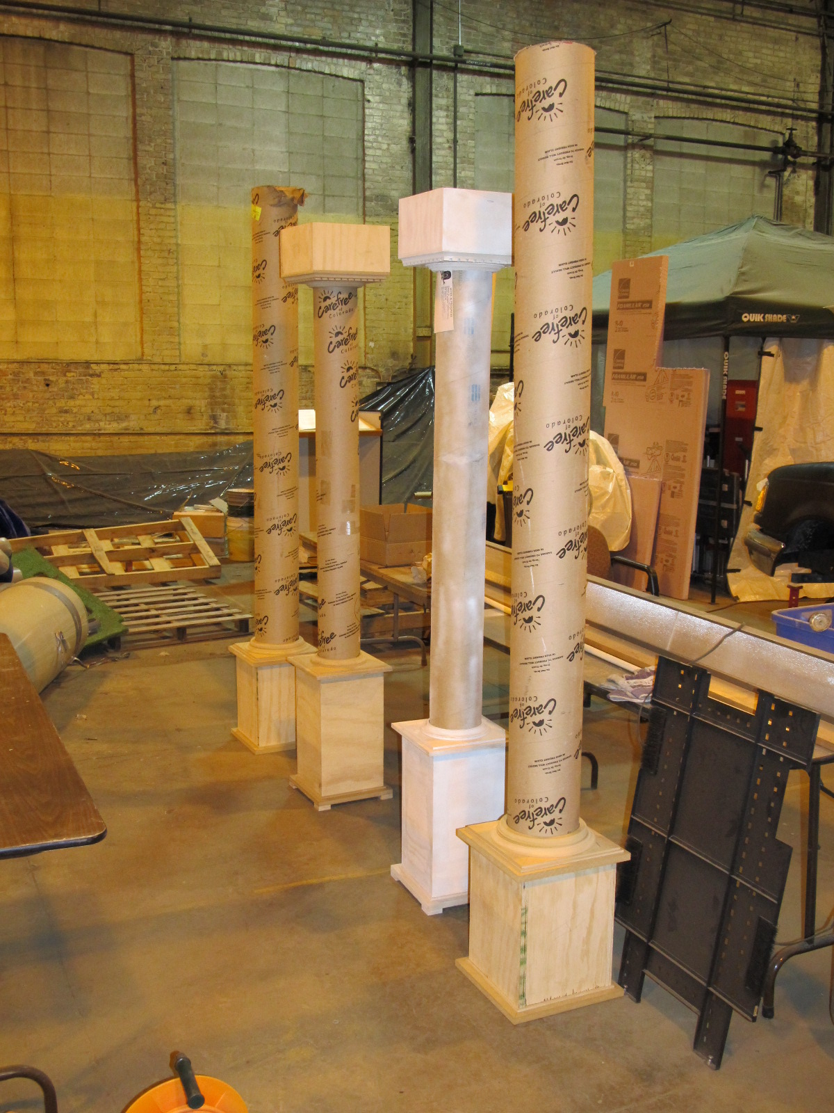 A set of 4 columns, two of which need the capitals created yet.