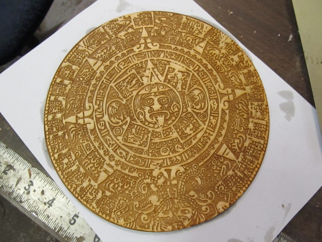 A laser cut image of an Aztec or Mayan Calendar