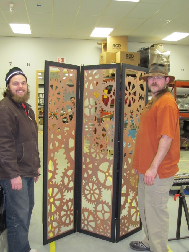 A picture of myself, Jason, and Matt, standing around the room divider