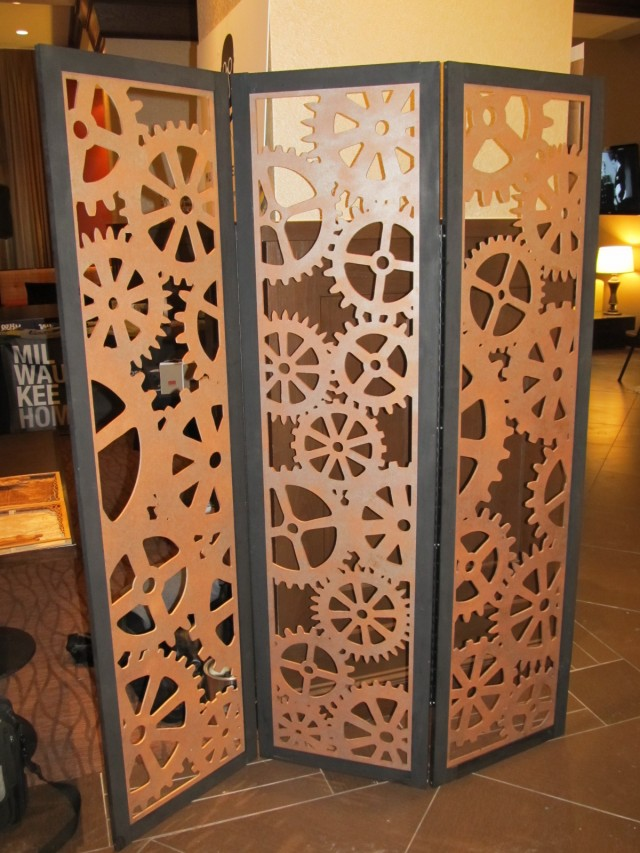 A 6 foot tall, clockwork gear inpired, tri-fold room divider