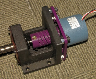 Motor mounted on screw assembly